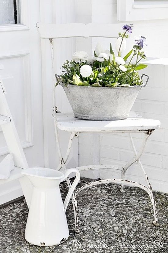 stand for flowers from a chair