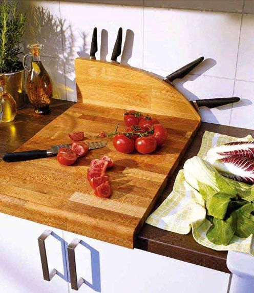 Cutting boards with built-in knives storage