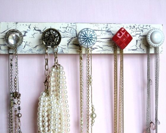a necklace hanger and beads from door handles
