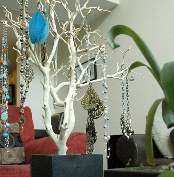 storing ornaments on a tree branch
