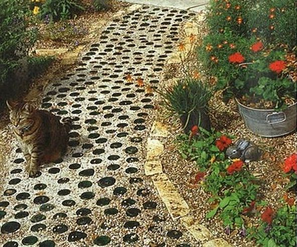 a path in the garden of glass bottles