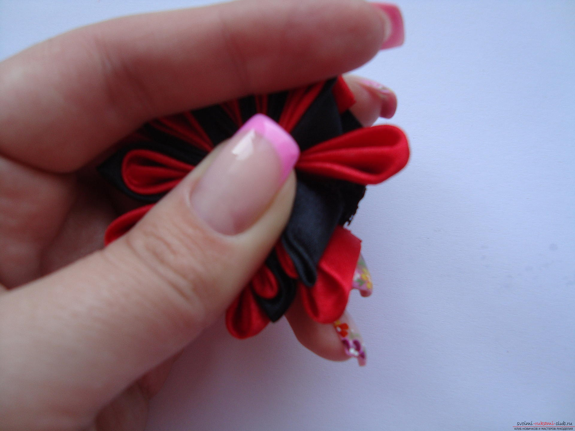 Step-by-step instruction on how to make a satin flower. Photo number 16