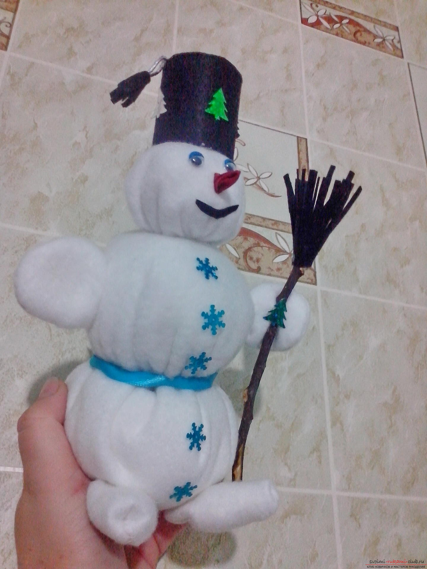 Snowman with Snow Maiden and Santa Claus should be in every house for the New Year. My Snowman I created with my own hands from fleece. Photo №1