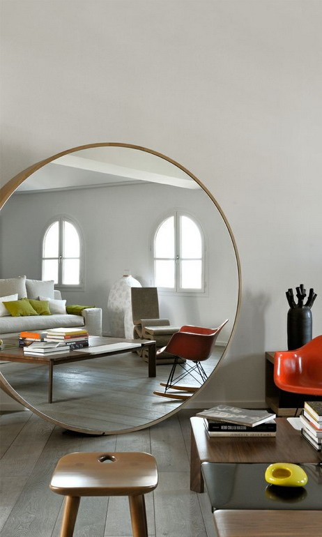 Large round mirror on the living room floor photo