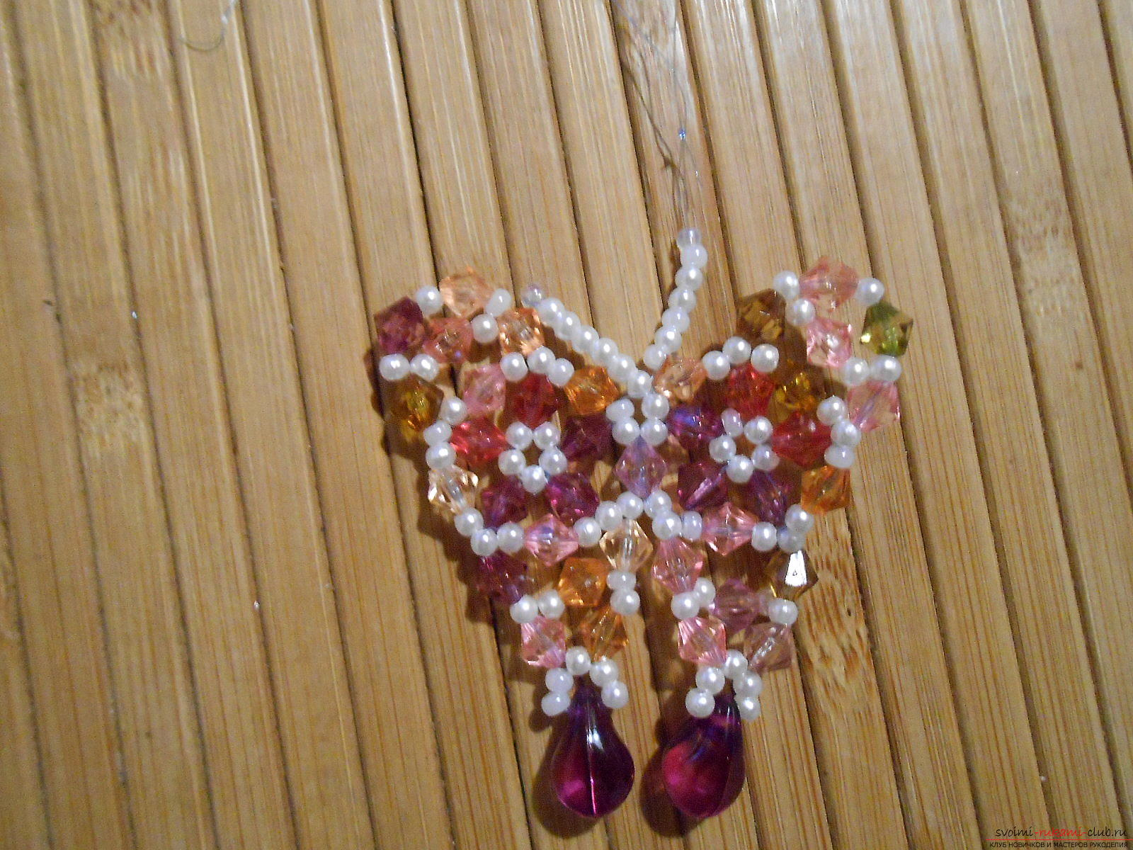 This detailed master class will teach the weaving of a butterfly from beads. Photo №25