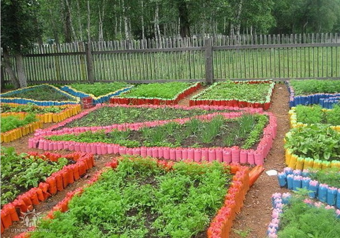 We decorate flower beds with plastic bottles
