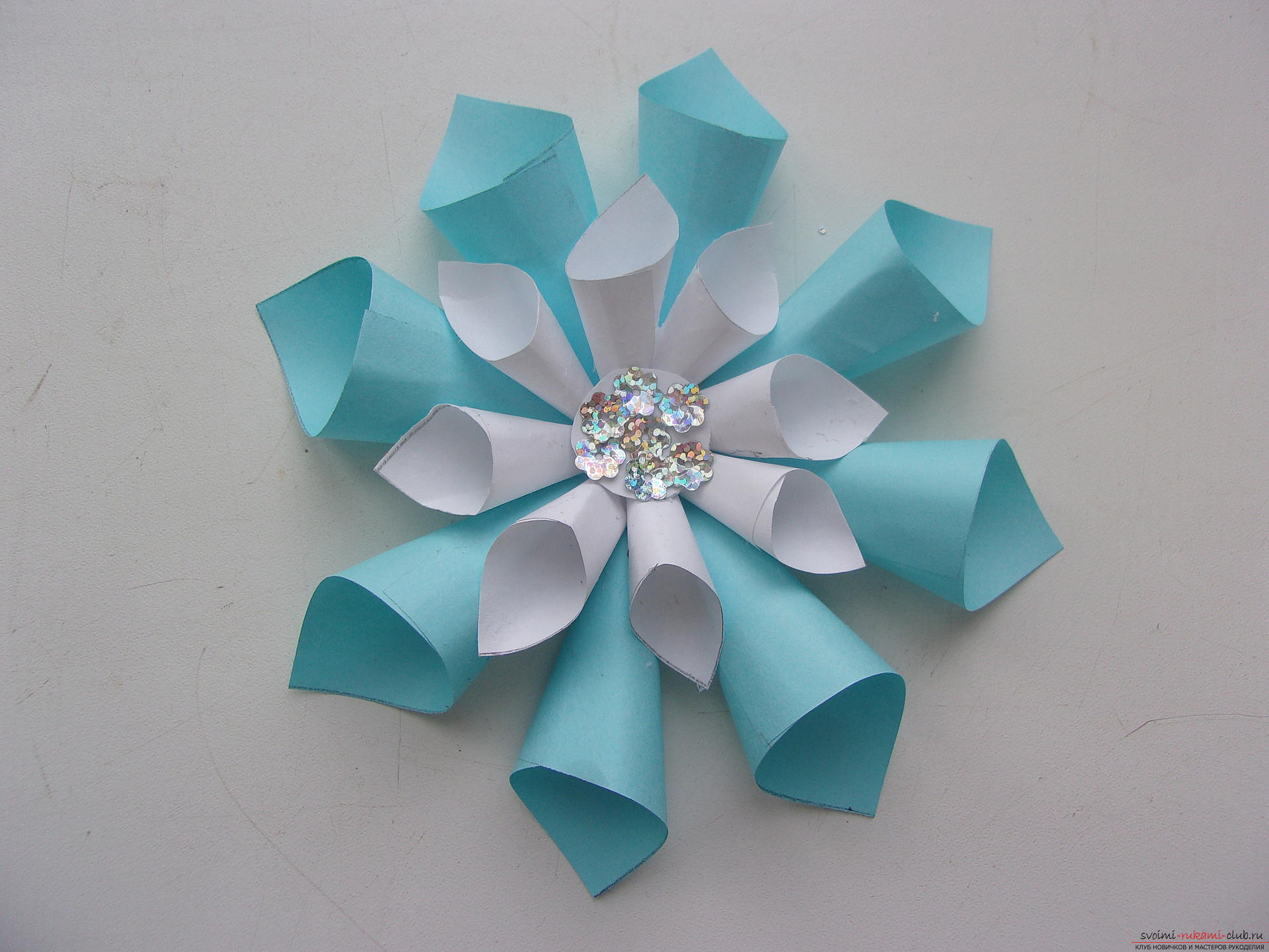 Beautiful snowflakes from paper can make even children. In our master class you will see a photo of a snowflake with a step-by-step description .. Photo №7
