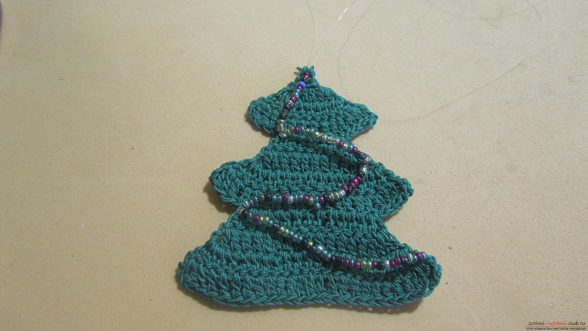This master class New Year crafts with their own hands with a photo and description will teach how to tie a Christmas tree crochet. Photo number 20
