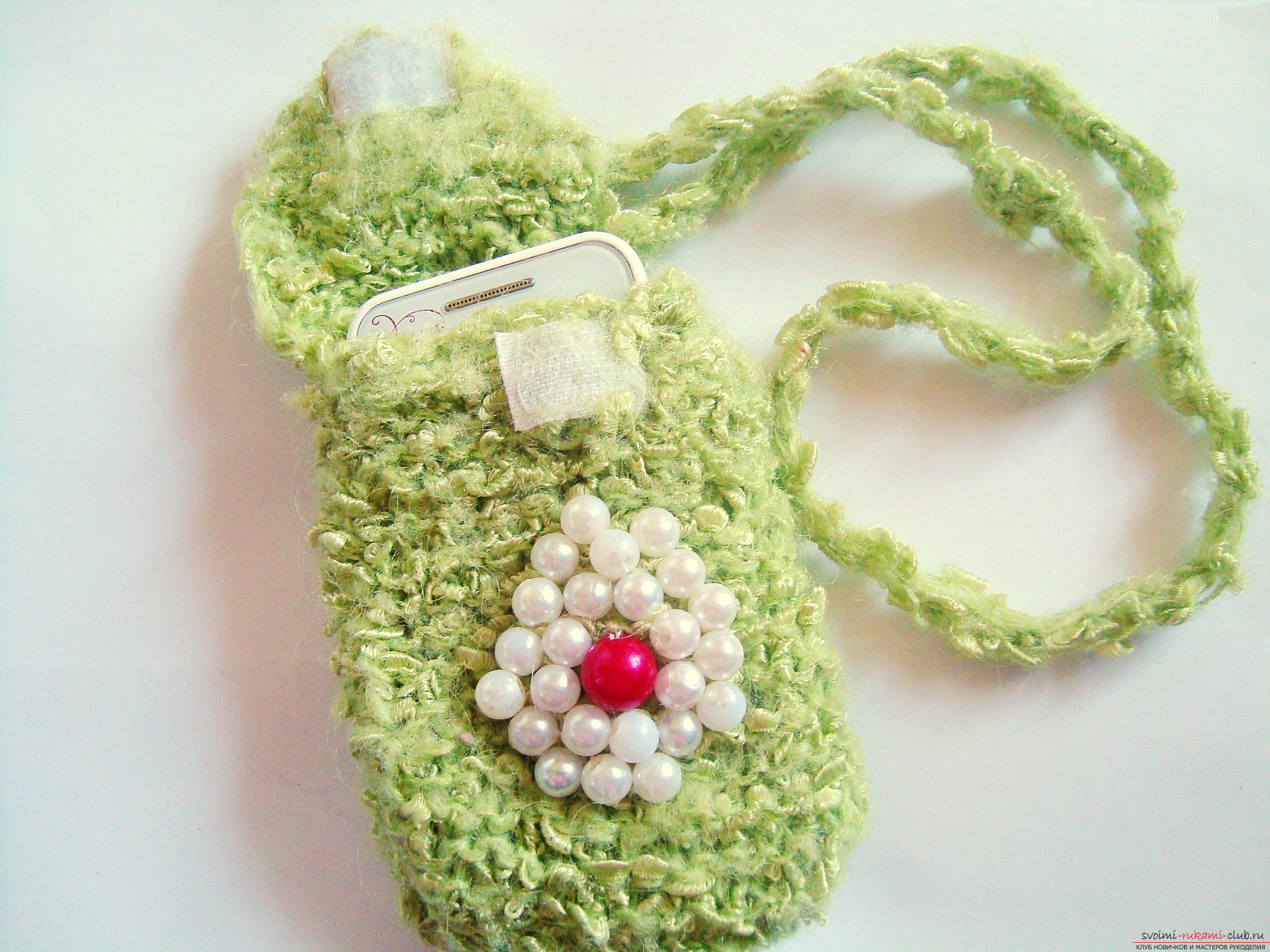 Step-by-step instruction with photos on the knitting of a cover for a mobile phone. Photo # 2