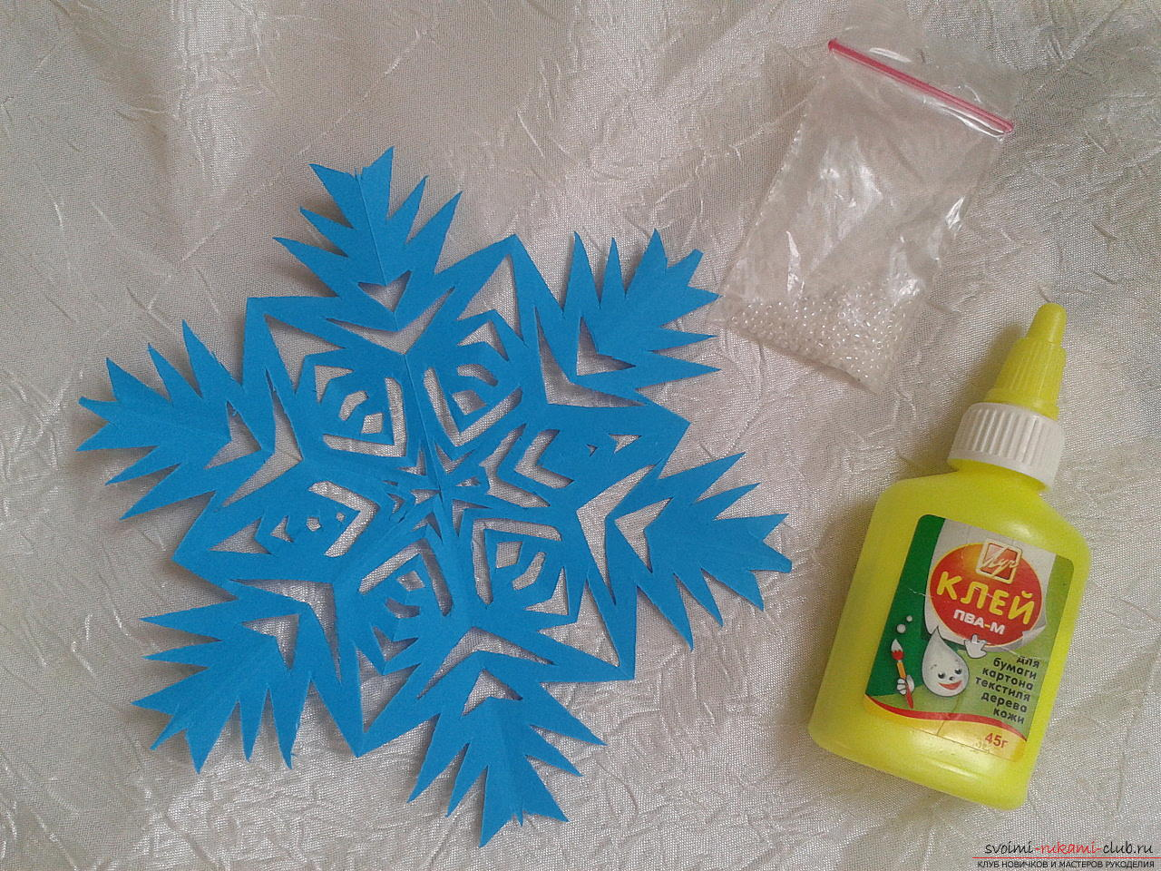 Photo to the lesson on creating a New Year's paper snowflake. Photo №13