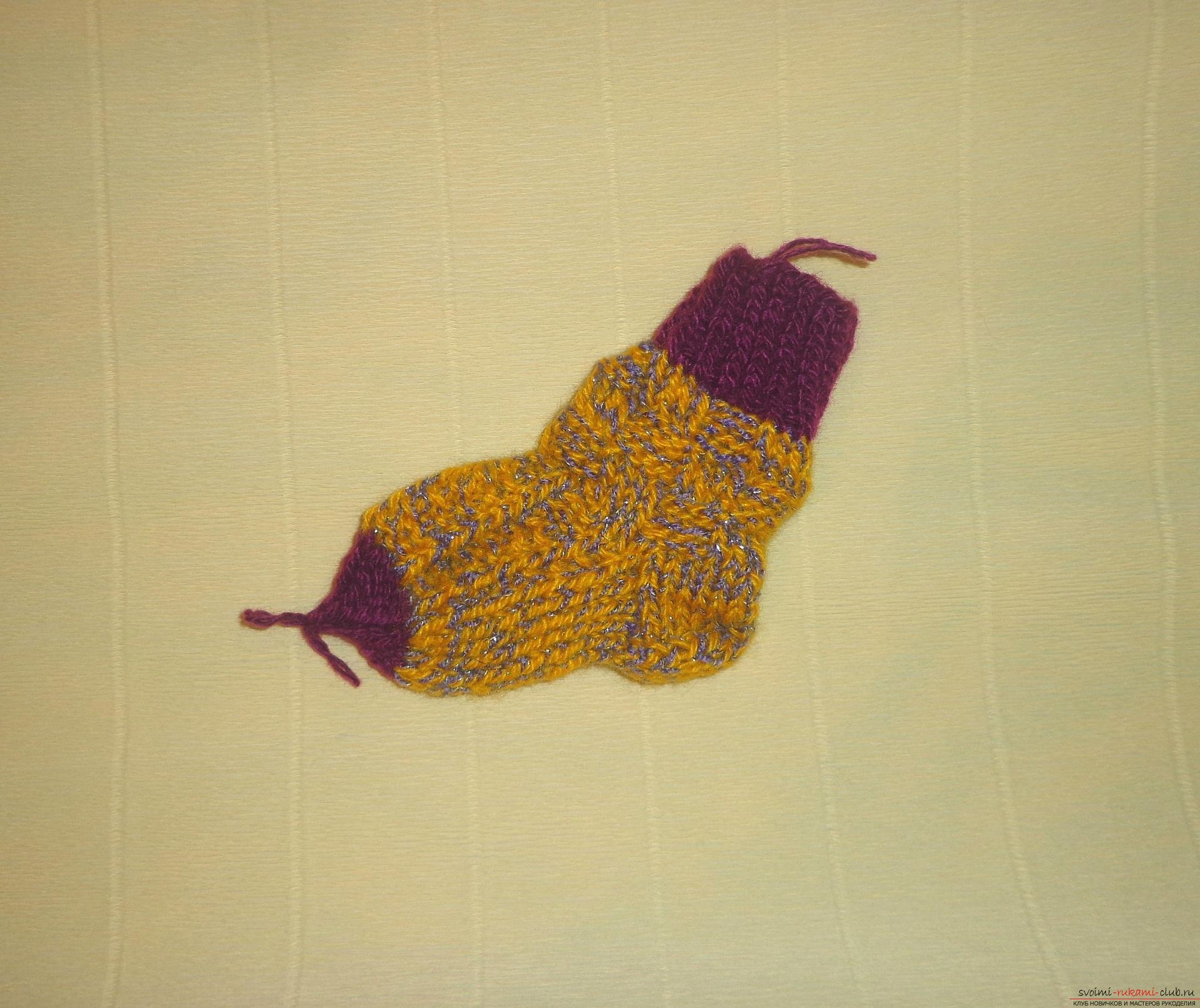 """Photo to the lesson on knitting with knitting needles of children's socks """"Winter"""". Photo Number 11"""
