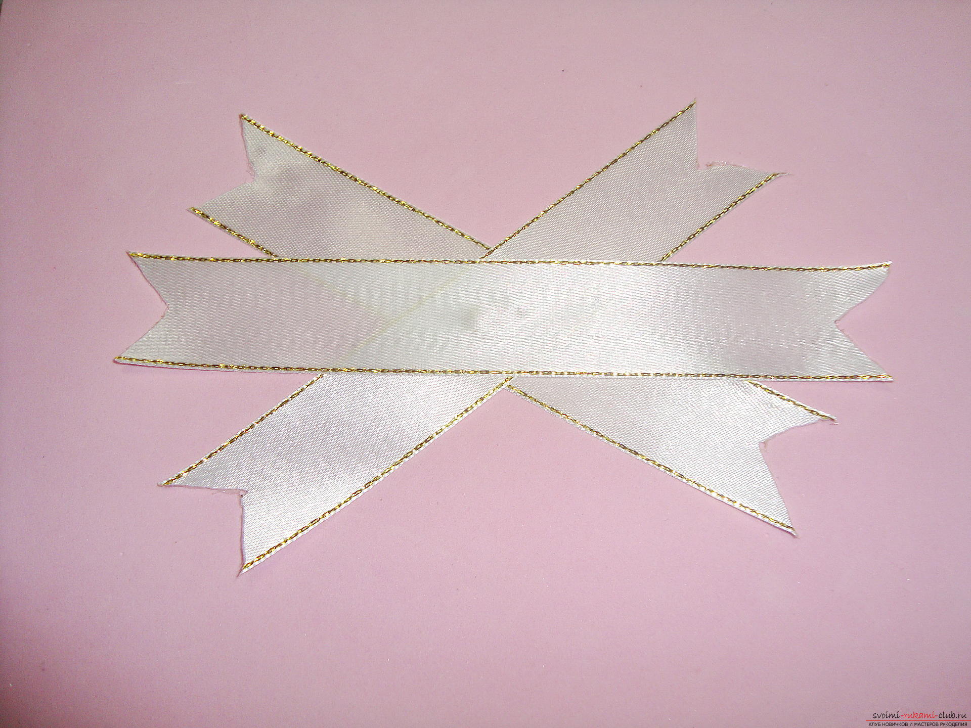 Photo-instruction for making festive bows for girls. Photo №6