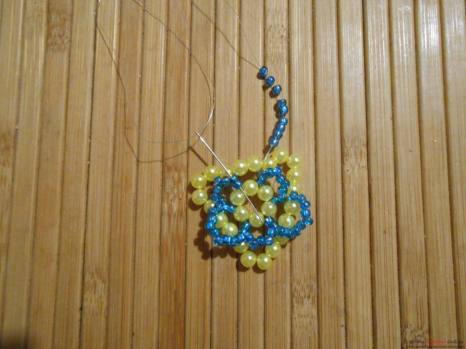 This master class of weaving from beads will tell you how to weave the earrings yourself .. Photo # 16