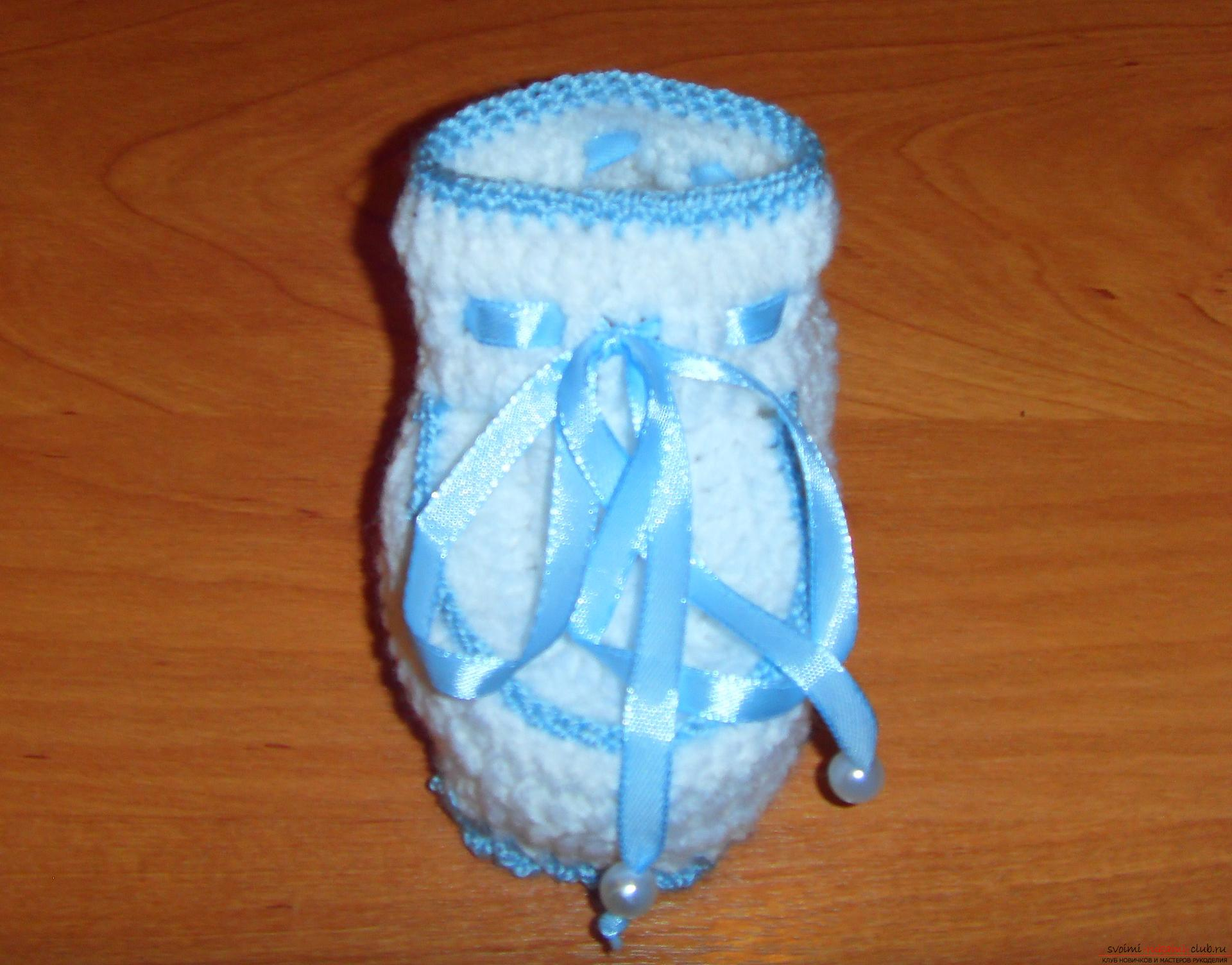 A master class with a detailed description will teach how to crochet booties for newborns. Photo Number 14