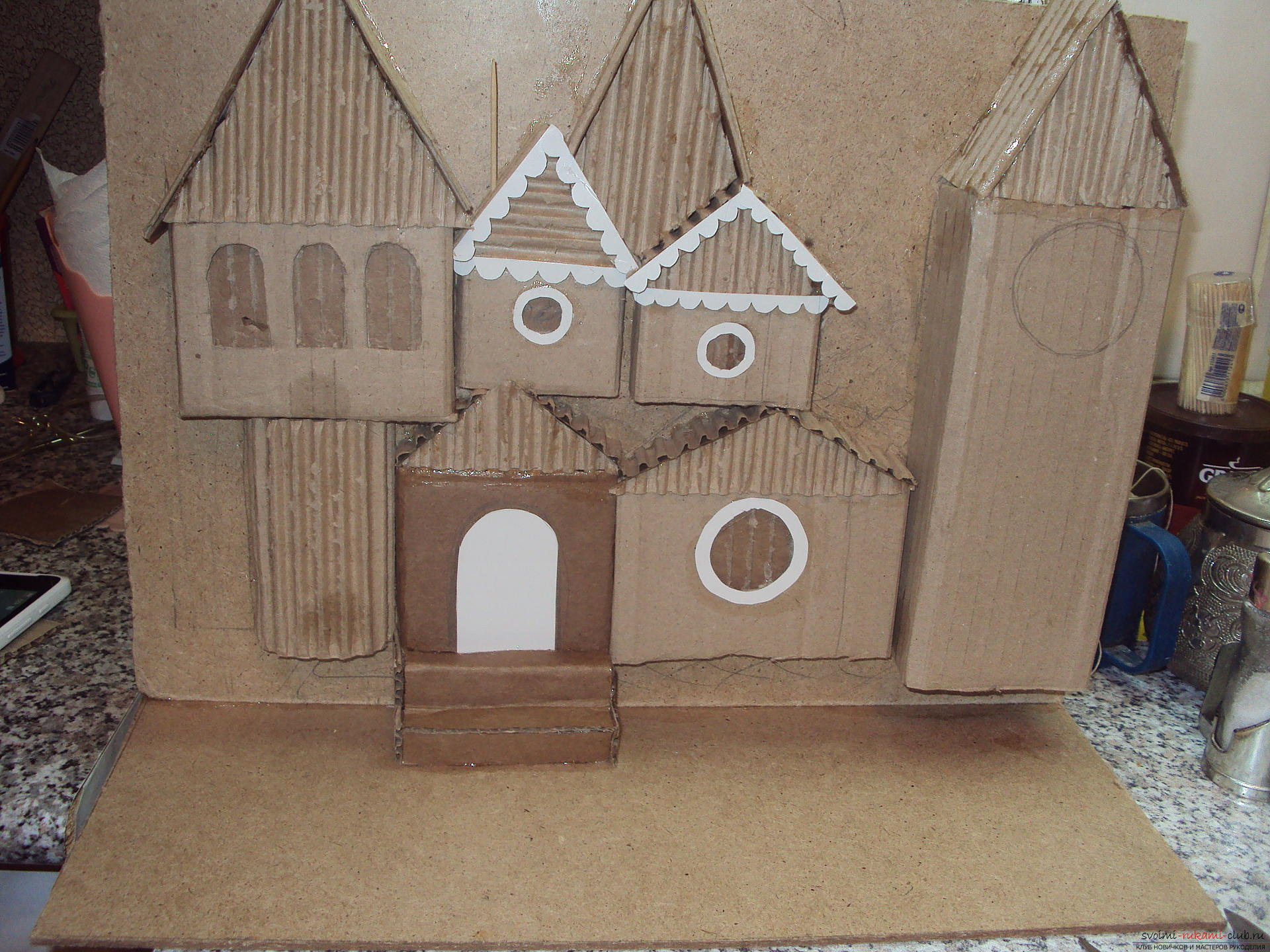 This workshop will teach how to make their own hands crafts - tower of Santa Claus. Photo №4