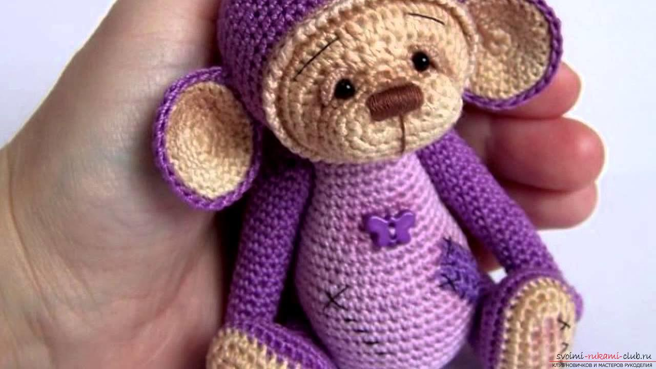Monkey amigurumi with his hands with a step-by-step description and photo. Photo Number 9