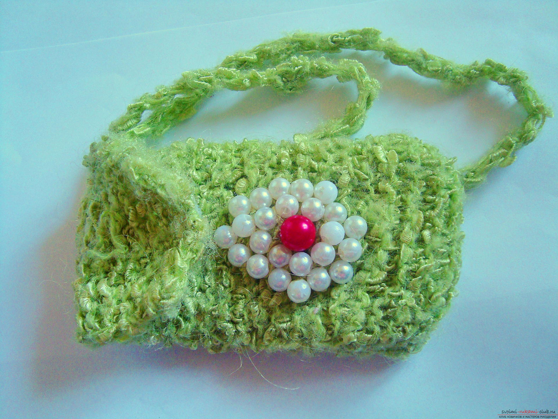 Step-by-step instruction with photos on the knitting of a cover for a mobile phone. Photo Number 9