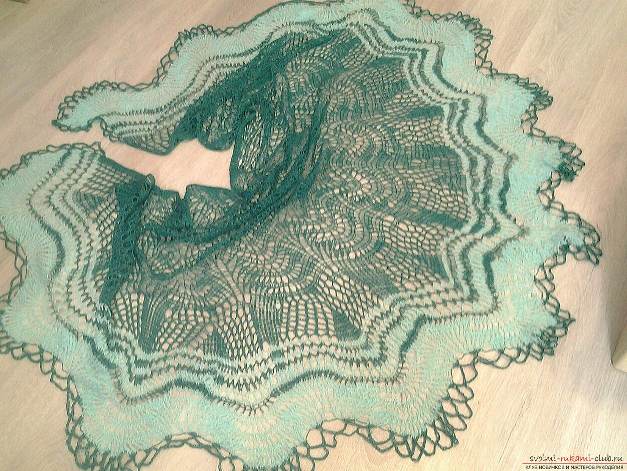 An openwork shawl made of merino wool. Photo # 2