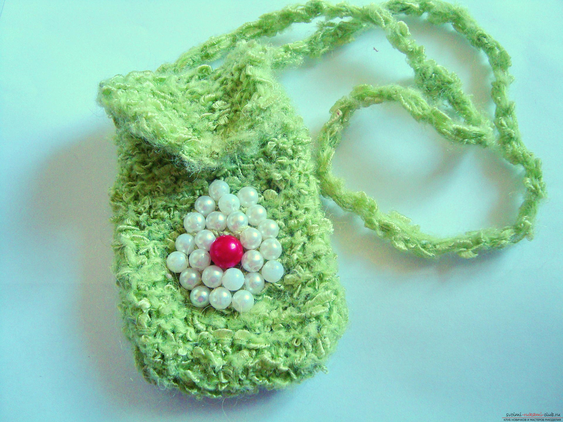 Step-by-step instruction with photos on the knitting of a cover for a mobile phone. Photo №1