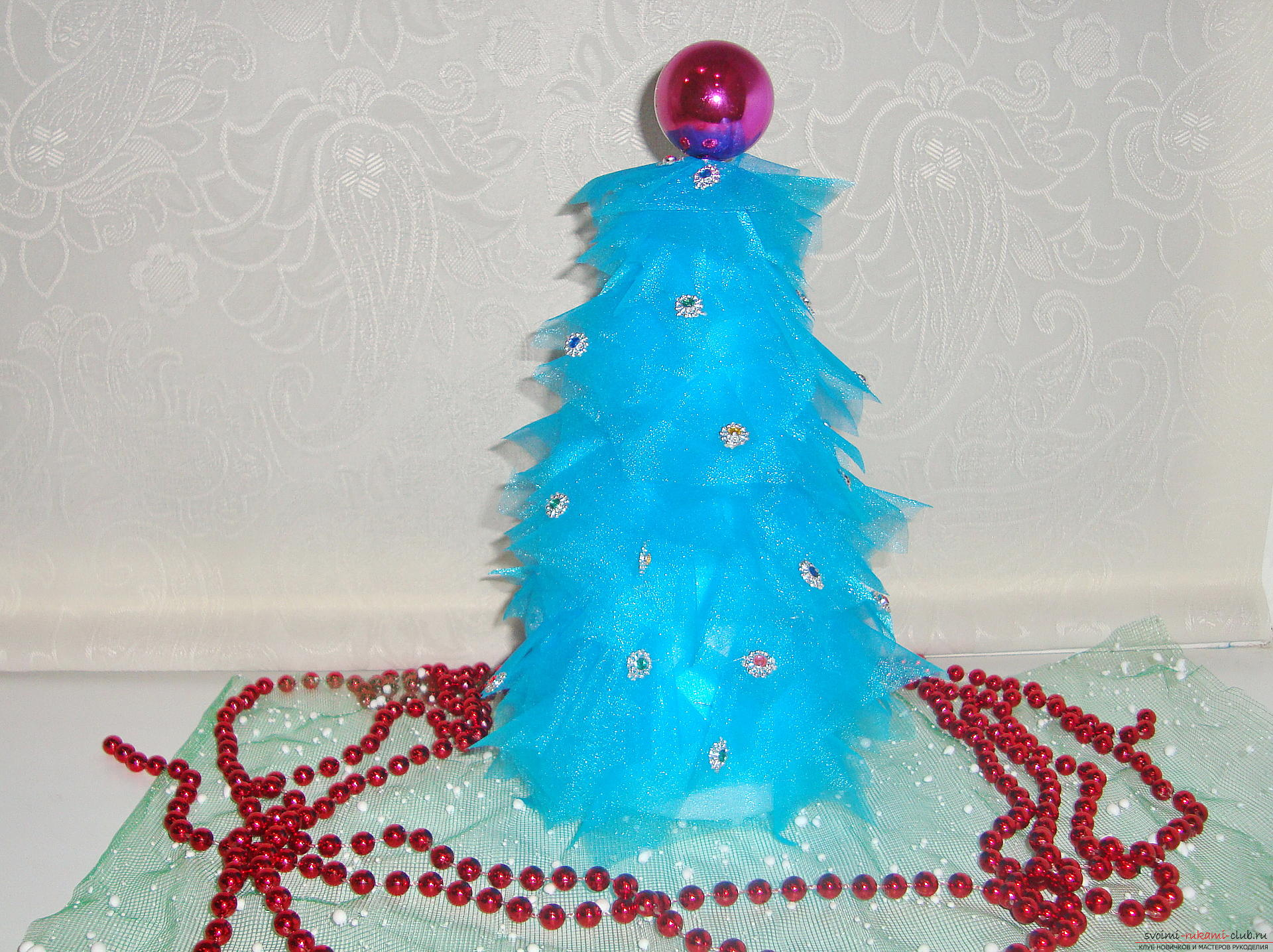 How to make a Christmas tree with your own hands from organza? this New Year's craft is easily created from easily material with the help of a stapler and glue, it will perfectly suit the gift of 2016. Photo number 1