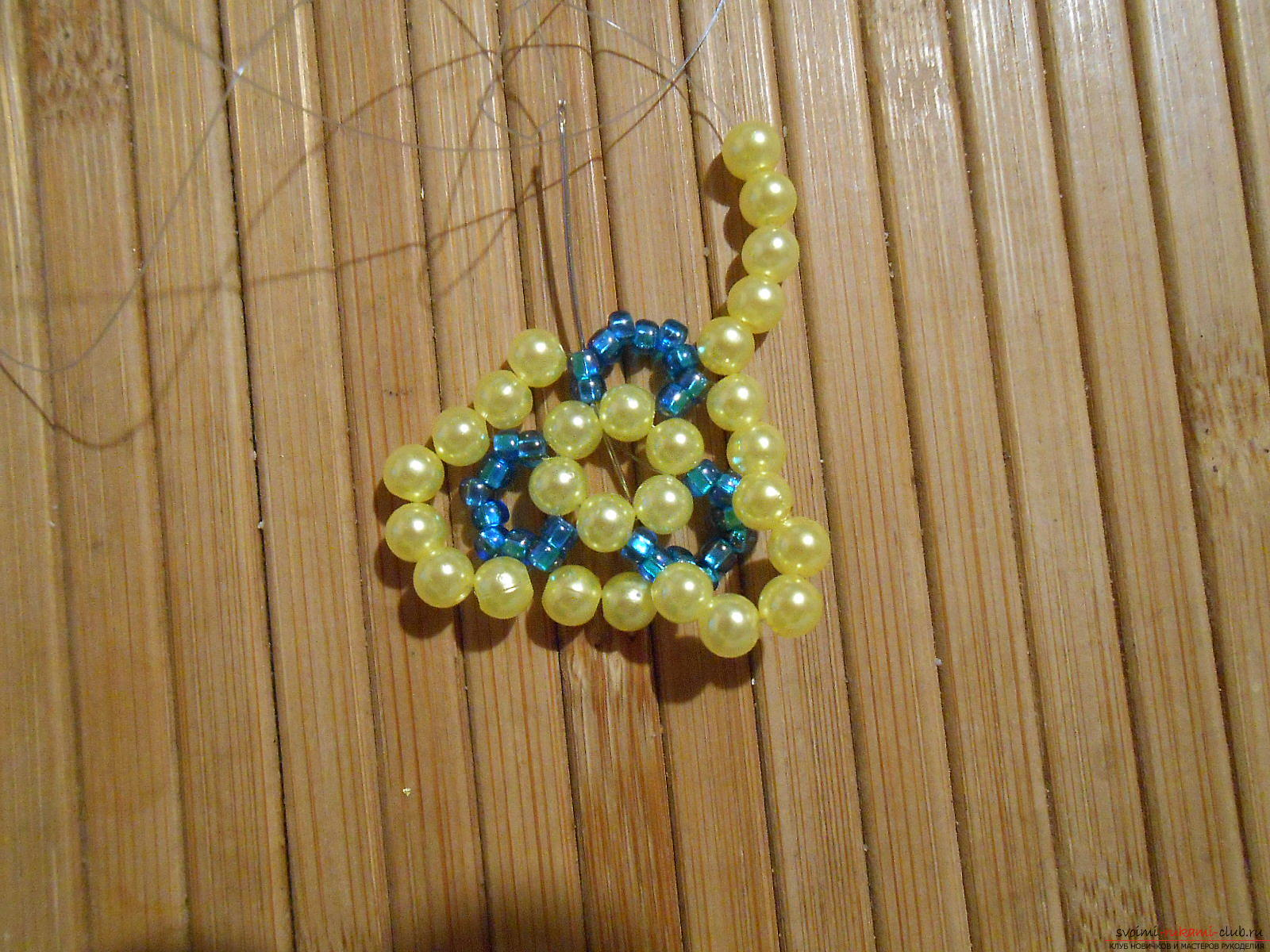 This master class of weaving from beads will tell you how to weave the earrings yourself. Photo # 12