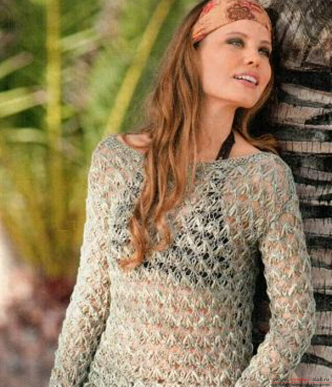 Knitted with knitting needles a female pullover with an openwork pattern. Photo №4