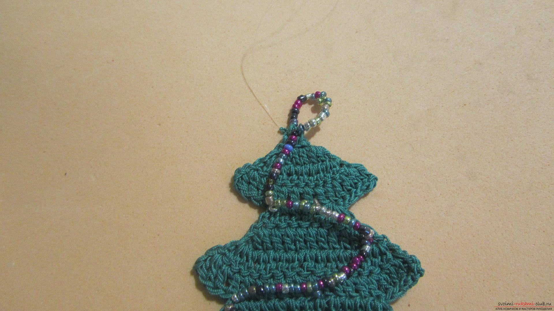 This master class New Year crafts with their own hands with a photo and description will teach how to tie a Christmas tree crochet. Photo Number 21