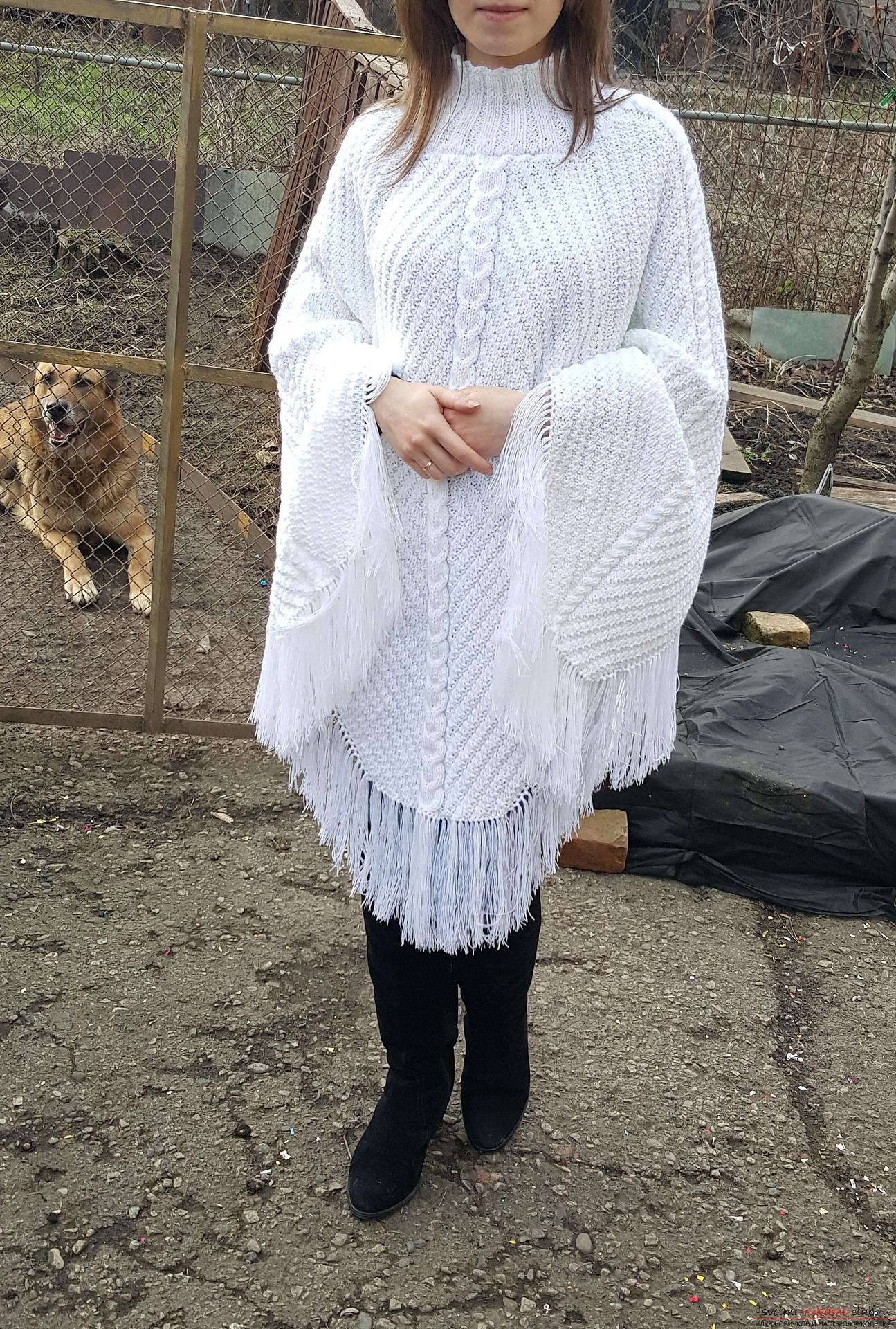Knitted poncho from acrylic yarn with the addition of wool. Photo # 2