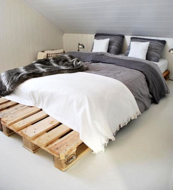 base under mattress from wooden pallets with white-gray bed