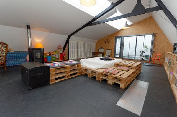 large bed with a chest of drawers by hand from wooden pallets