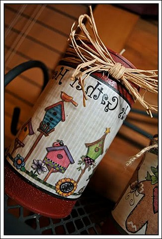 Decorated cans can be used to store cereals in the kitchen while decorating the interior