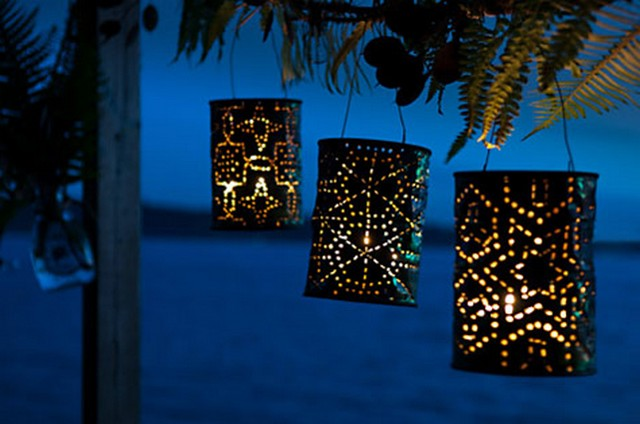 With the help of holes, cans can easily turn into lampshades and lamps