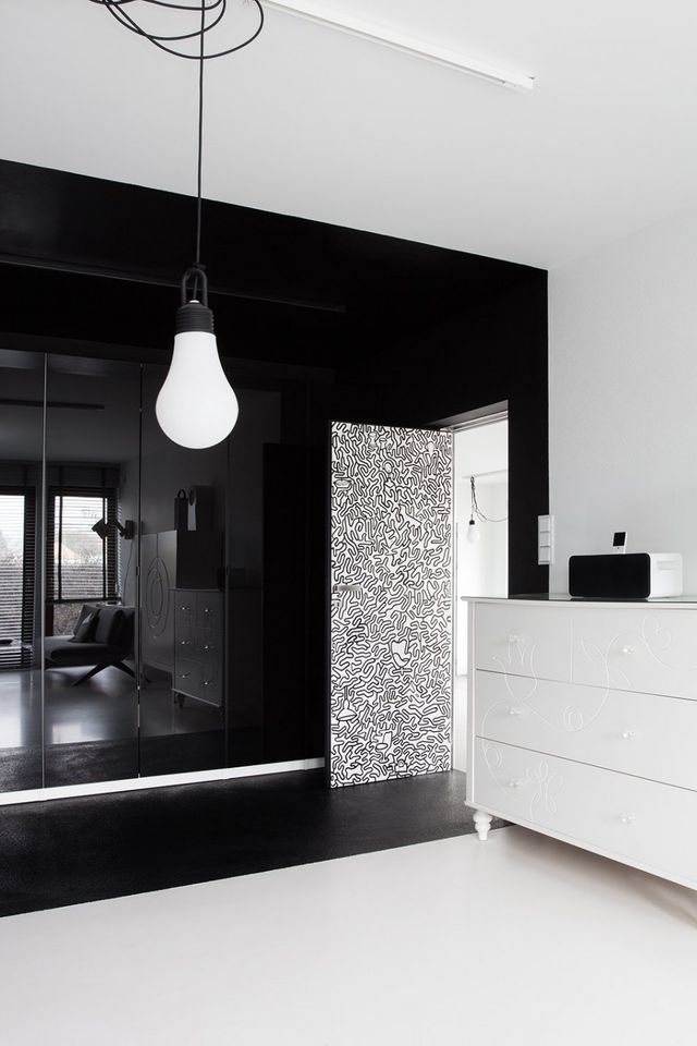 door in the black and white interior of the bedroom