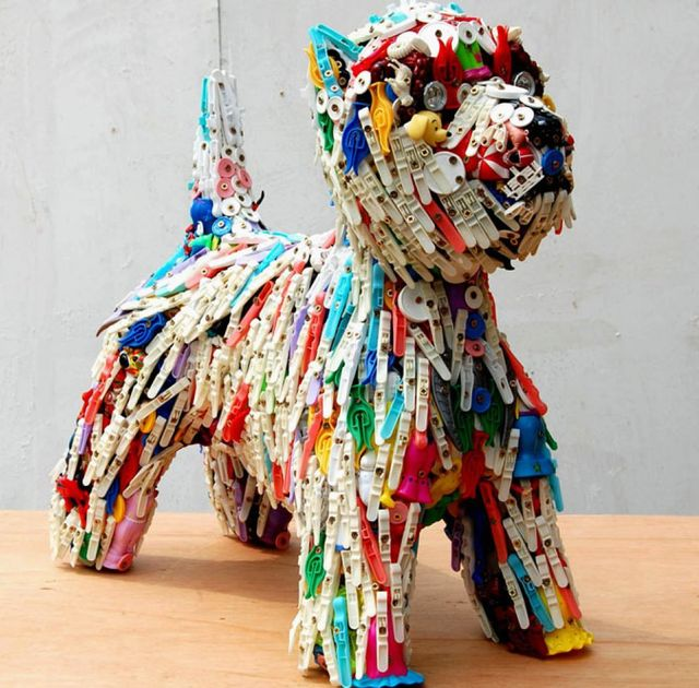 A dog - a sculpture of toys and clothes pegs