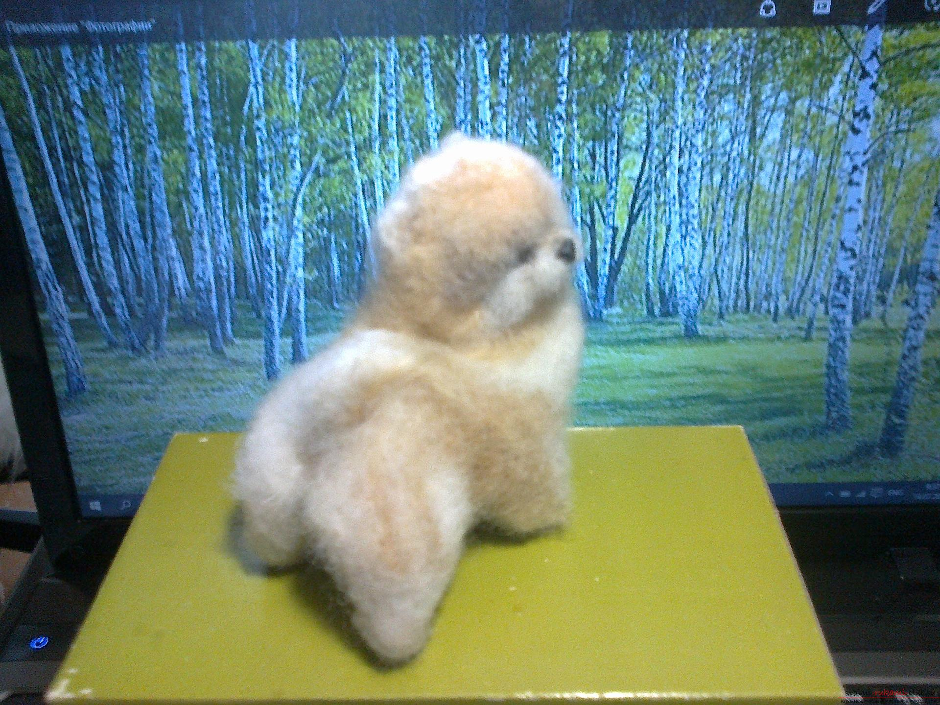 The original toy is a dog made in the technique of dry felting. Photo # 2