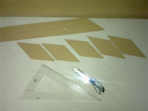 Cutting out the details of the screen from the cardboard