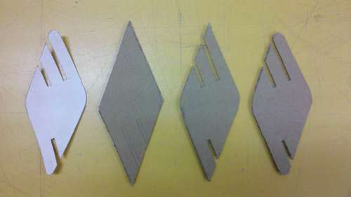 Cutting out parts D from cardboard