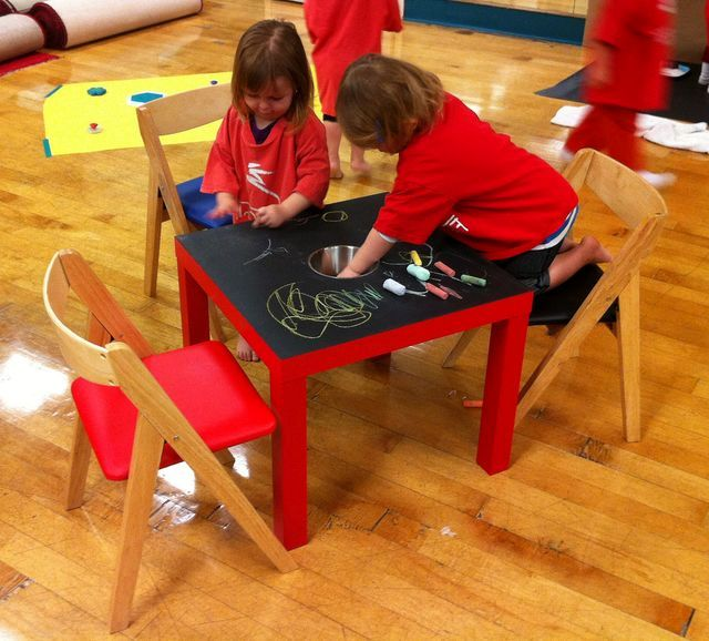children draw chalk on a table