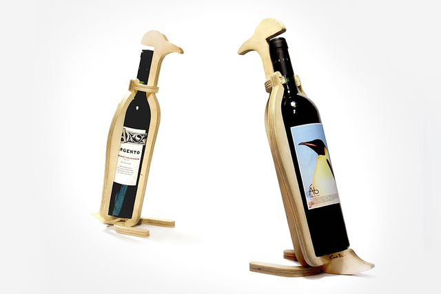 wine bottle supports in the form of penguins