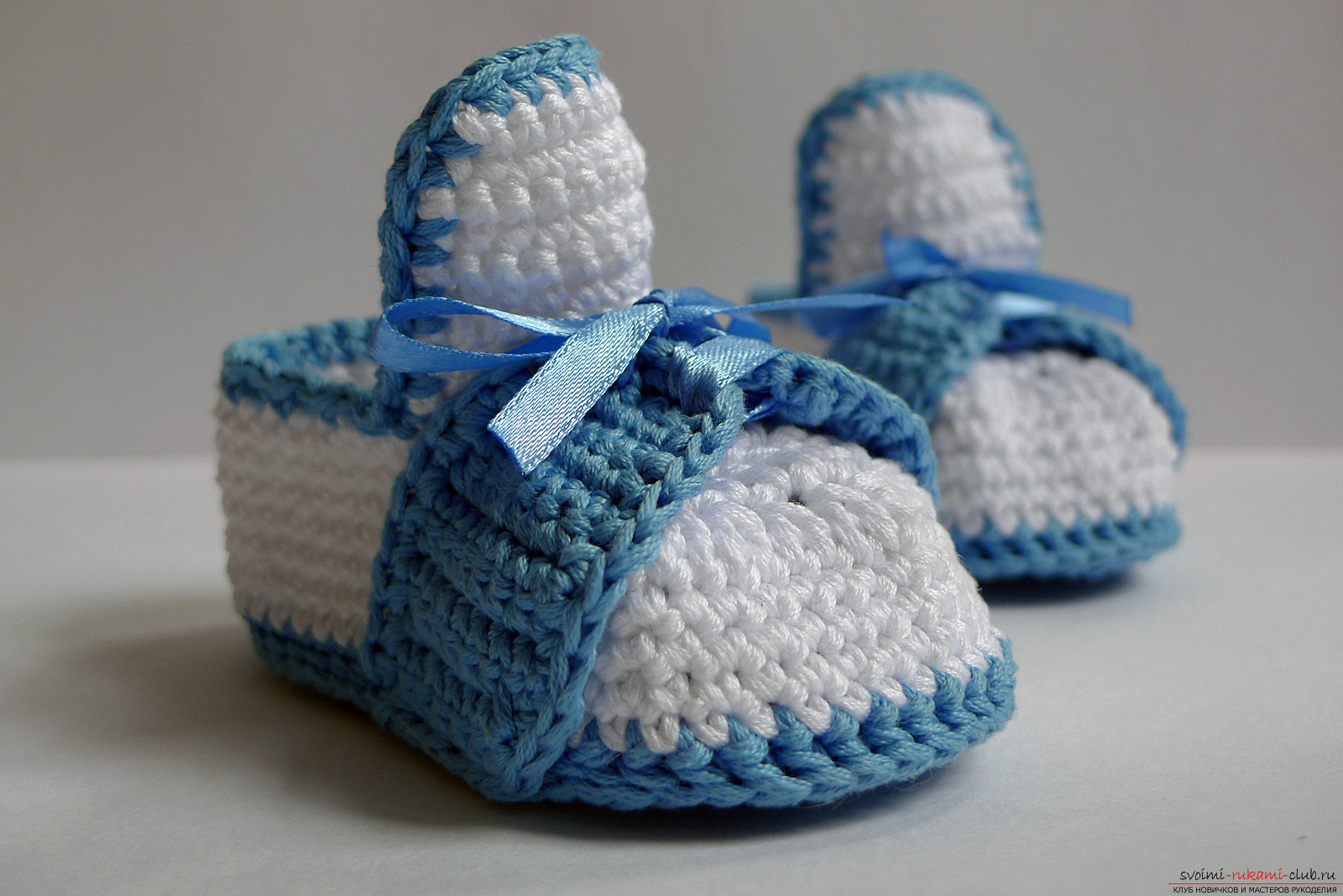 Knitted baby booties. Photo # 2