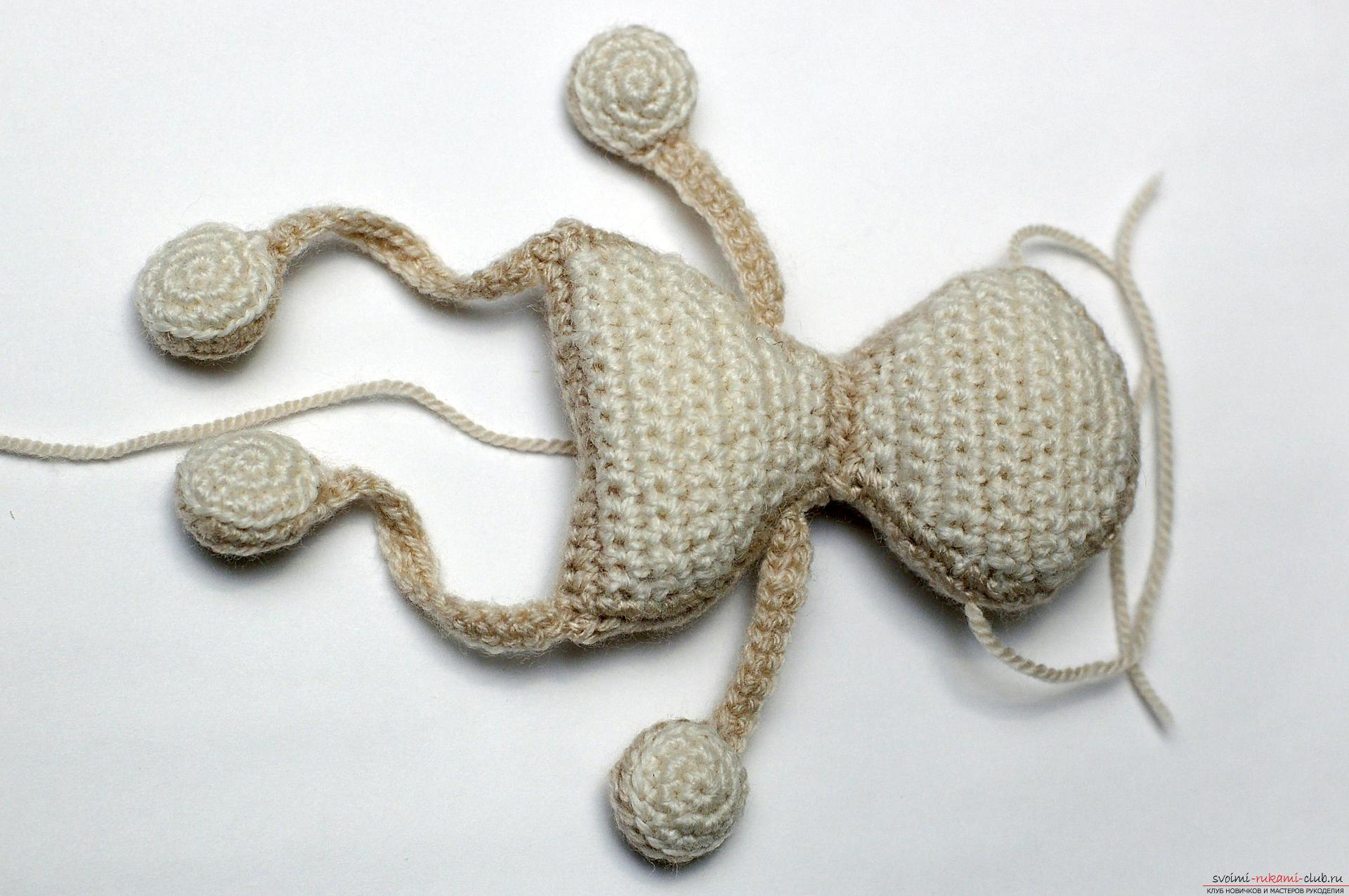 A master class with a detailed description and photo will show how to crochet a toy-symbol of the year - a monkey on a Christmas tree. Photo Number 21