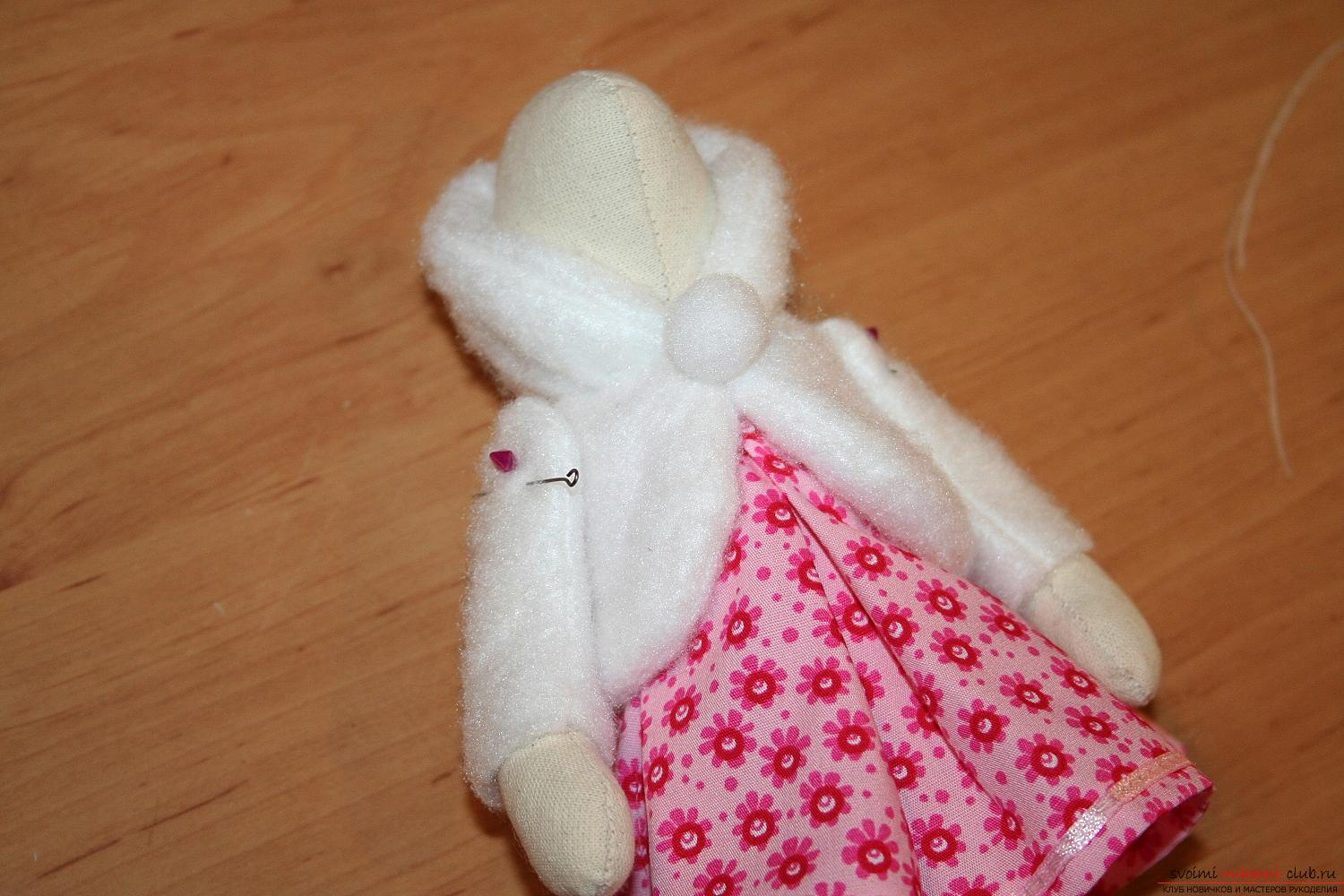 A master class on the creation of a New Year's doll will help to make a hare to Tilda with his own hands. Photo №41