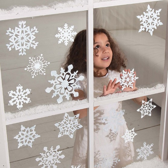 Window decor made of paper snowflakes