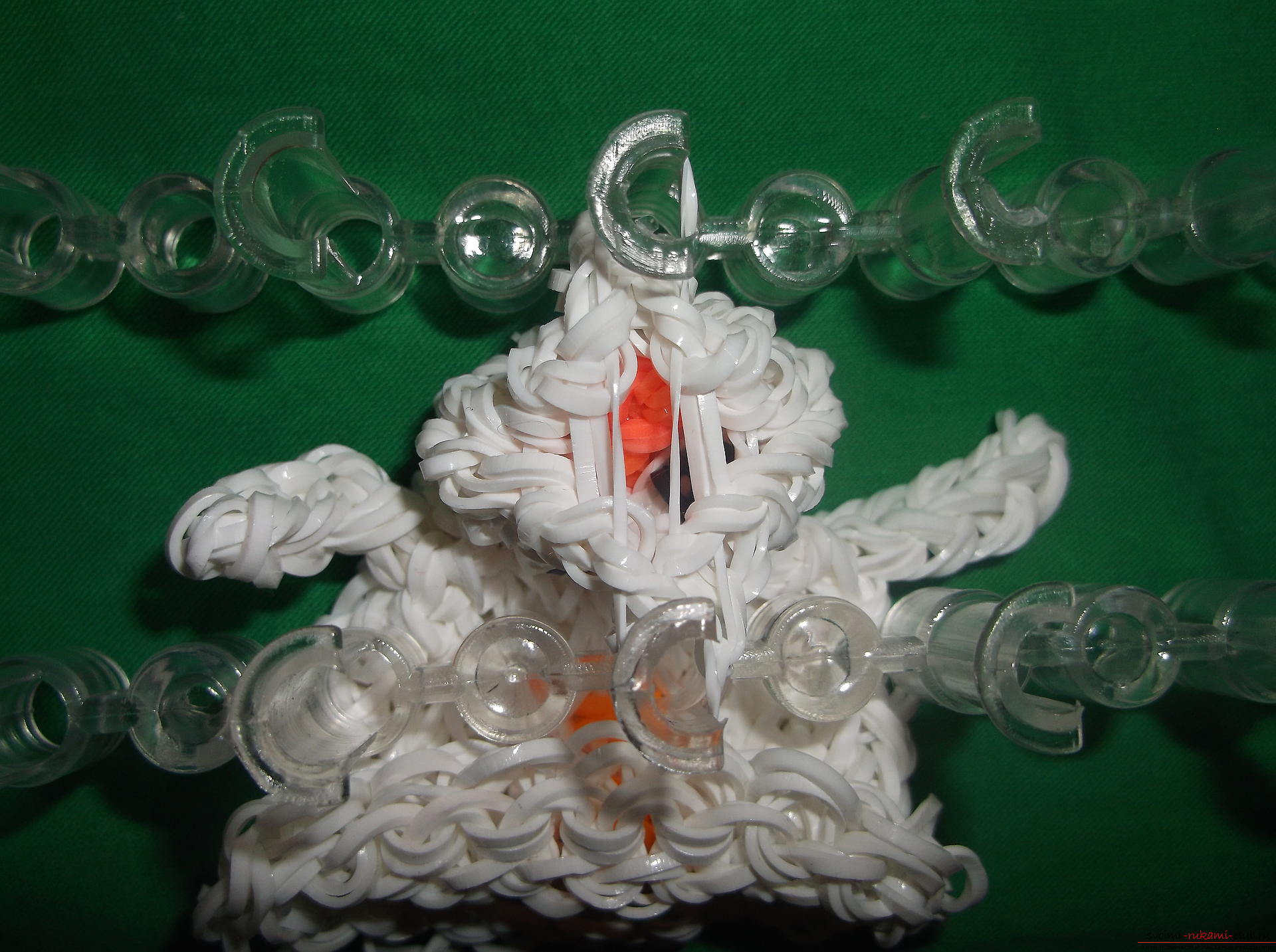 A photo for a lesson on weaving of snowman's rubber bands for the New Year holidays. Photo Number 14
