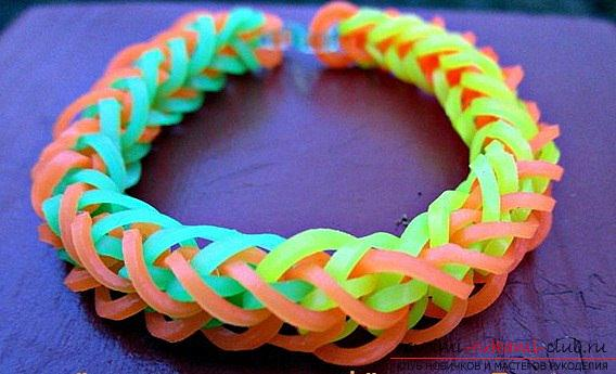 Learning to weave bracelet French braid from colored rubber with own hands photo. Photo №7