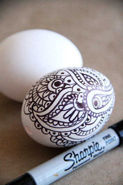 painting of Easter eggs with a black marker