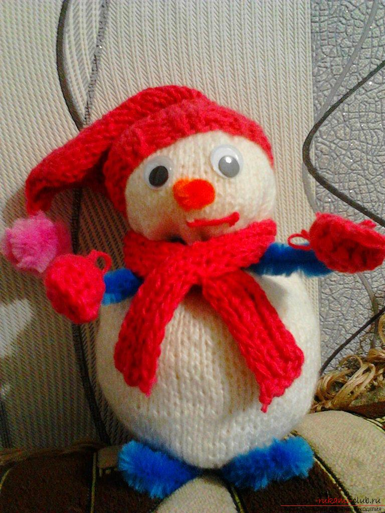 Snowman tied with knitting needles. Photo №1