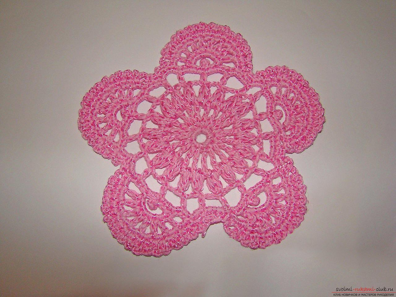 A master class of knitting with a diagram and a photo will teach you how to crochet an openwork flower with a crochet. Photo Number 14