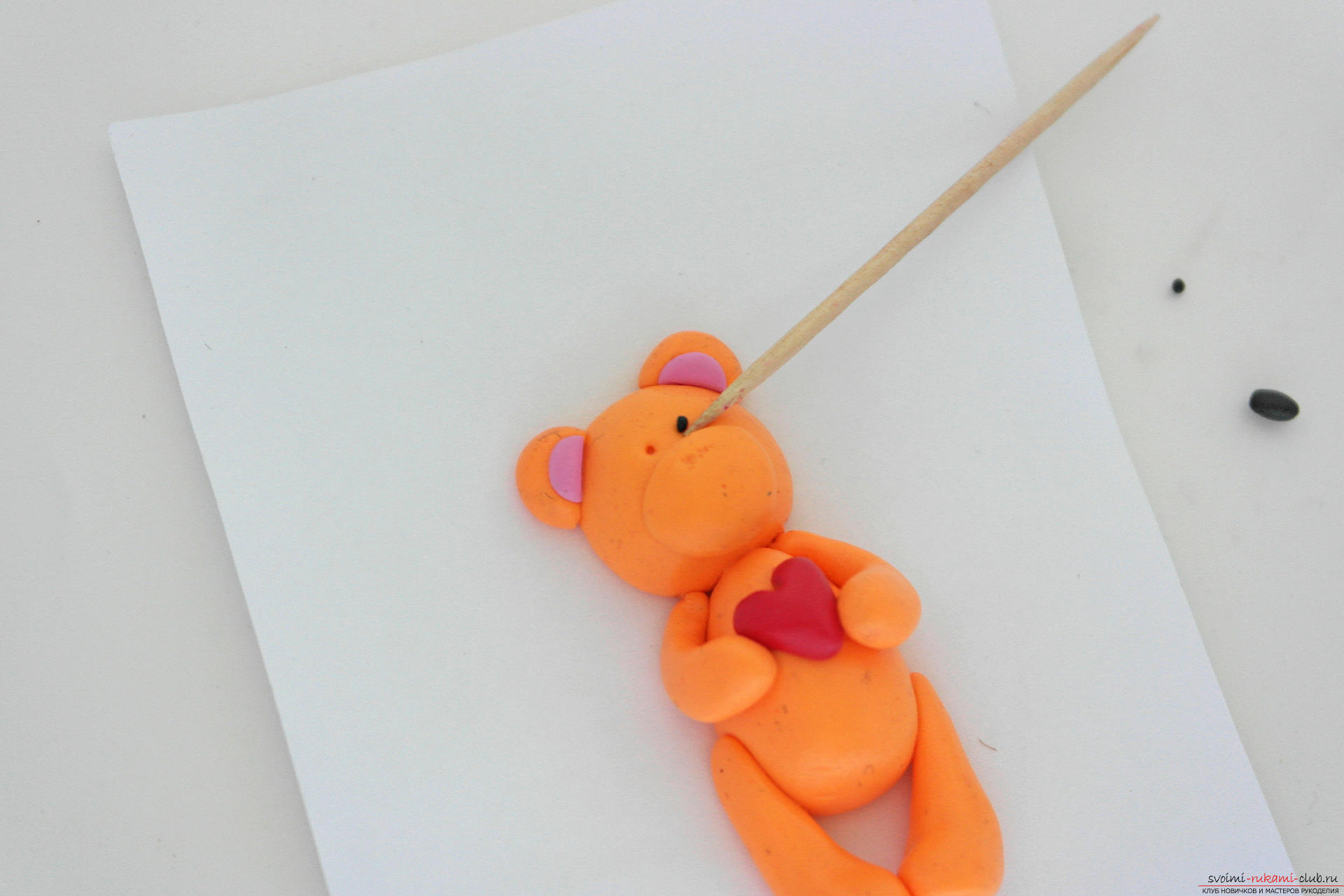 This detailed master class will teach you how to make a figurine of polymer clay - a keychain in the form of a bear cub. Photo # 25
