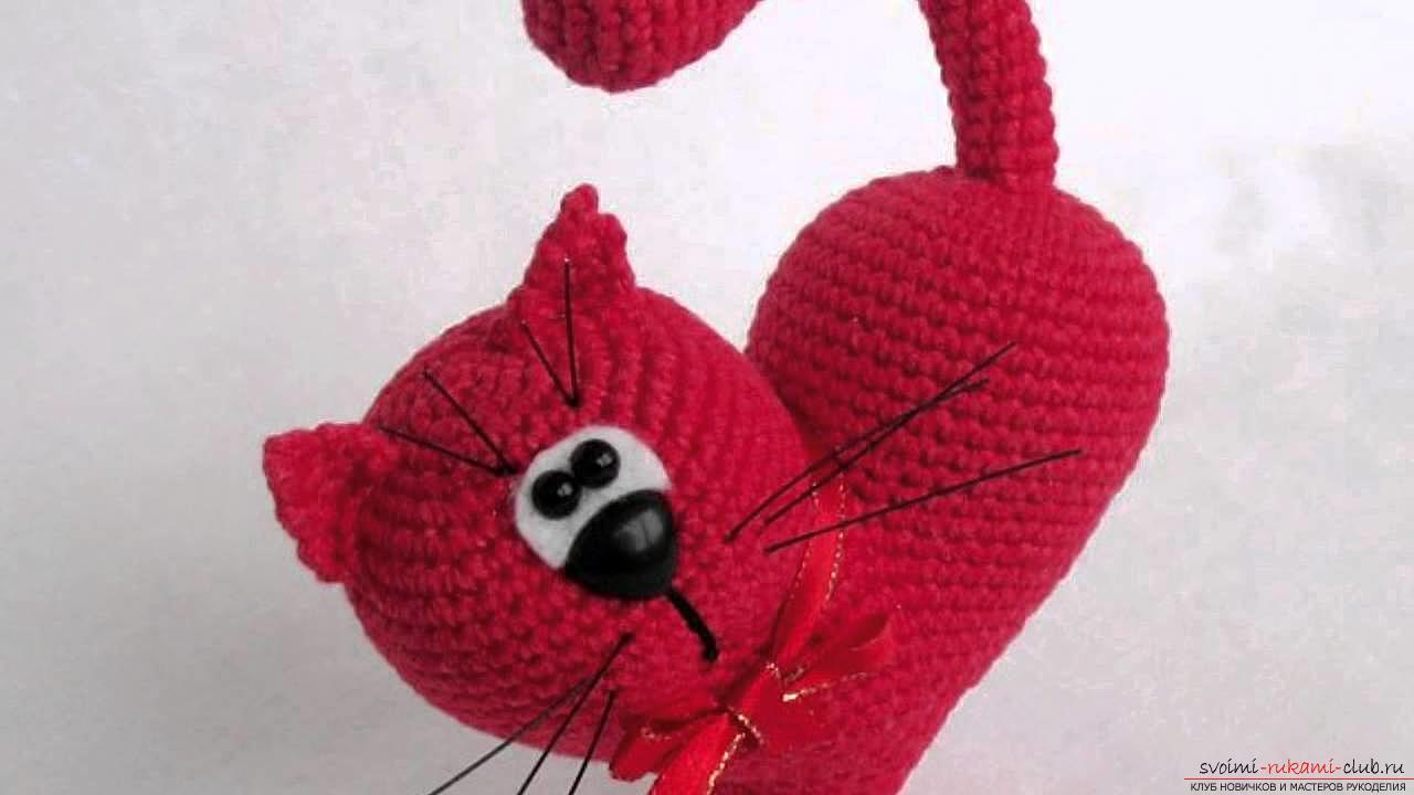 We knit an amigurumi cat in the shape of a heart with our own hands with a photo and description. Photo number 17